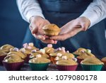 chef pastry in a black apron... | Shutterstock . vector #1079080178