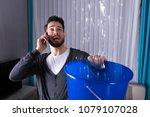 worried young man calling... | Shutterstock . vector #1079107028