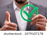 close up of a businessperson's... | Shutterstock . vector #1079107178