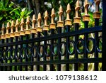 black aluminum fence with gold... | Shutterstock . vector #1079138612