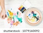 a person begins to paint on a... | Shutterstock . vector #1079160092