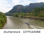 view of three small boats on... | Shutterstock . vector #1079164088