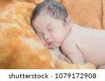 cute little newborn baby curled ... | Shutterstock . vector #1079172908
