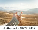 a man's hand holds a hand held... | Shutterstock . vector #1079212385