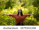 young woman spreading arms to... | Shutterstock . vector #1079241338