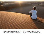 woman admiring the sunset on... | Shutterstock . vector #1079250692