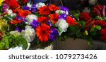 """Small photo of Colorful fresh floral wreaths for Anzac Day holiday memorial celebrations 25th April in Bunbury, Western Australia to honor and remember those who gave their lives in battles- """"Lest we forget."""""""