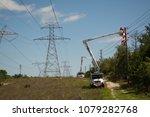 line crews make repairs long... | Shutterstock . vector #1079282768