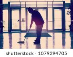 janitor mopping the floor | Shutterstock . vector #1079294705