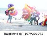 blur people on the beach | Shutterstock . vector #1079301092
