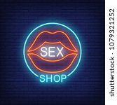 Stock vector lips with sex shop lettering in circle neon sign on brick background store electric sign 1079321252