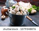 raw mushrooms  raw champignons  ... | Shutterstock . vector #1079348876