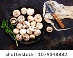 raw mushrooms  raw champignons  ... | Shutterstock . vector #1079348882