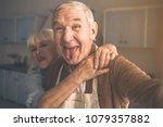 portrait of joyful senior... | Shutterstock . vector #1079357882