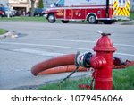 fire hydrant with hose charged