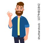 cheerful young man standing and ... | Shutterstock .eps vector #1079481842