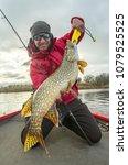 Happy Fisherman With Big Pike...