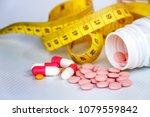 diet concept  slim by pills ... | Shutterstock . vector #1079559842