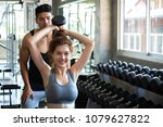 fitness man and asian woman... | Shutterstock . vector #1079627822
