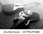 Electric Guitar And Acoustic...