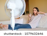 young woman relaxing under the... | Shutterstock . vector #1079632646