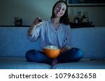 young woman watching tv sitting ... | Shutterstock . vector #1079632658