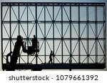 three workers in silhouette... | Shutterstock . vector #1079661392