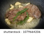 cooking meat with garlic oil... | Shutterstock . vector #1079664206