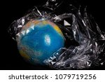 the globe covered in plastic ... | Shutterstock . vector #1079719256
