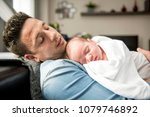 young father taking care of his ... | Shutterstock . vector #1079746892