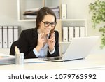 hopeful businesswoman waiting... | Shutterstock . vector #1079763992