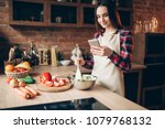 woman use phone while cooking... | Shutterstock . vector #1079768132