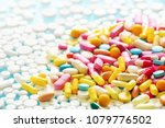 colorful pills on a blue... | Shutterstock . vector #1079776502