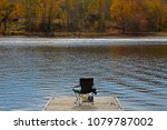 fishing rod leans on a camping... | Shutterstock . vector #1079787002