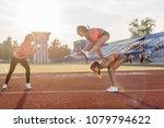 fit women in the stadium... | Shutterstock . vector #1079794622
