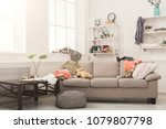 sofa in messy living room with... | Shutterstock . vector #1079807798