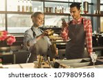 two bartenders recording... | Shutterstock . vector #1079809568