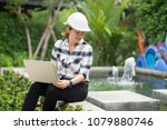 Small photo of World environment day concept ,Thai Asian Female engineering working with a tablet laptop at sewage treatment plant, engineer controlling the quality of water , aerated activated sludge tank