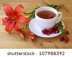 tea with ripe strawberries on... | Shutterstock . vector #107988392