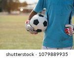 goalkeeper with a soccer ball... | Shutterstock . vector #1079889935