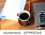 a cup of coffee and laptop on... | Shutterstock . vector #1079902265