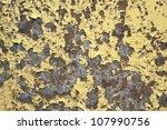rundown surface showing peeled yellow paint on rusty ground - stock photo