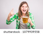 Cheerful Young Woman Holding A...