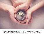 child and adult holding money...   Shutterstock . vector #1079946752