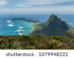 Looking down along the length of Lord Howe Island from the top of Mount Gower. Mount Lidgbird in the middle ground. New South Wales, Australia.