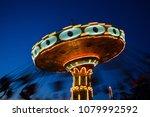 swing ride amusement park at... | Shutterstock . vector #1079992592