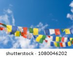 Abstract blur of colorful flags with vivid color use as tailsman for safety travel in tibetan on blue sky background
