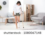 young woman with crutch and... | Shutterstock . vector #1080067148