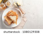 Plate With Toasted Bread And...