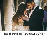 handsome groom kissing happy... | Shutterstock . vector #1080159875